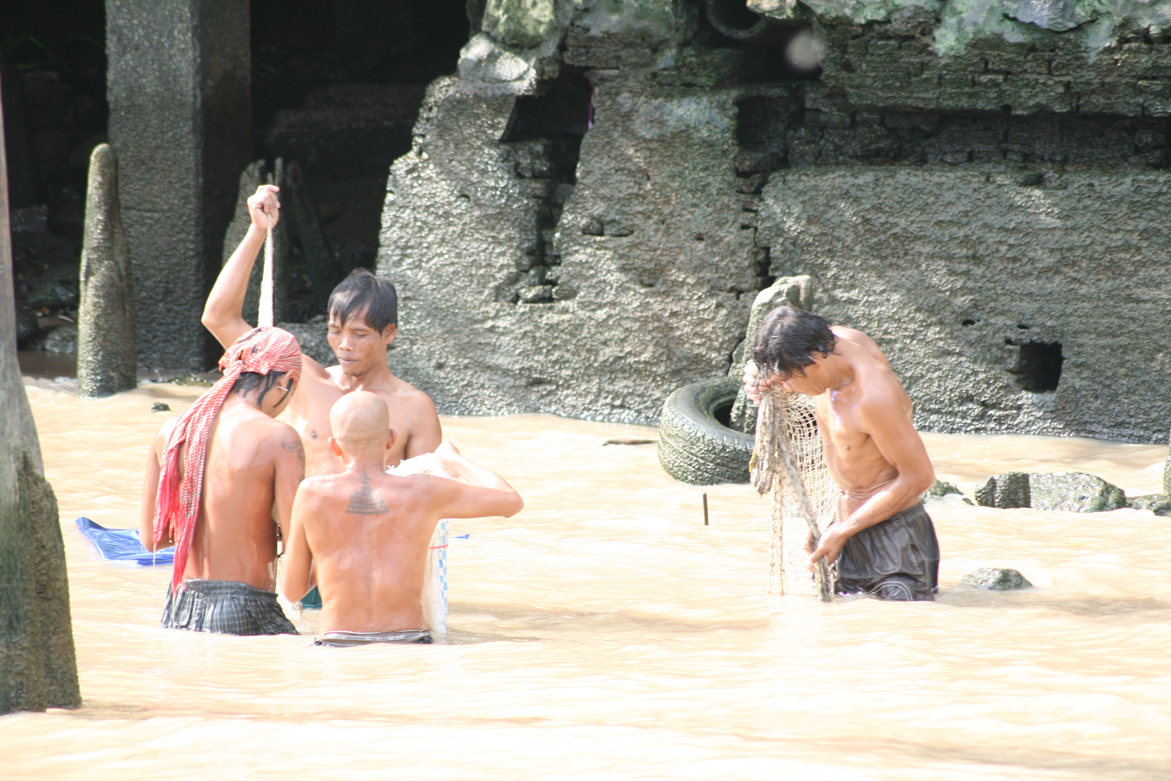 men washing in river, Thailand