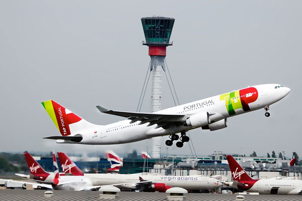 Sustainable tourism speaker and consultant - Air Portugal Plane